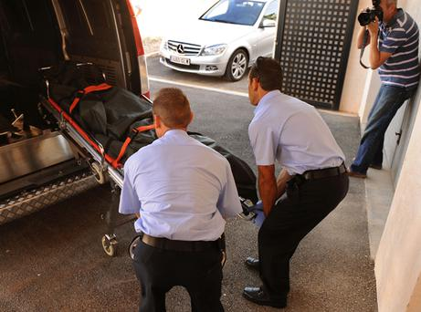 The body of Stephen Gately is wheeled into a funeral home in the village of Calvia in Mallorca