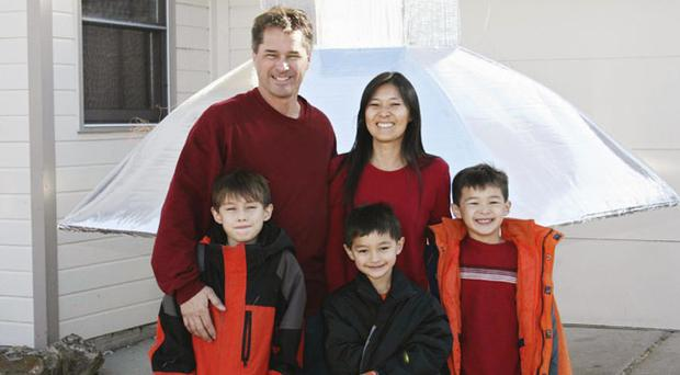 The Heene family, clockwise from back left, Richard, Mayumi, Ryan, Falcon and Bradford are shown at their home