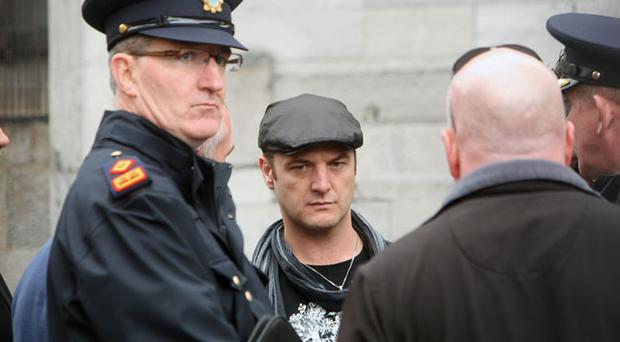 Mikey Graham of Boyzone chats with Gardai about the arrangements for the funeral