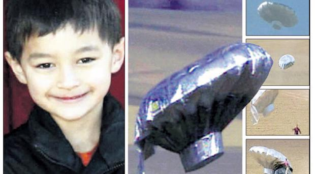 Rescuers retrieve the runaway balloon originally believed to have carried six-year-old Falcon Heene (left). Global audiences were gripped as the drama unfolded live on TV news channels
