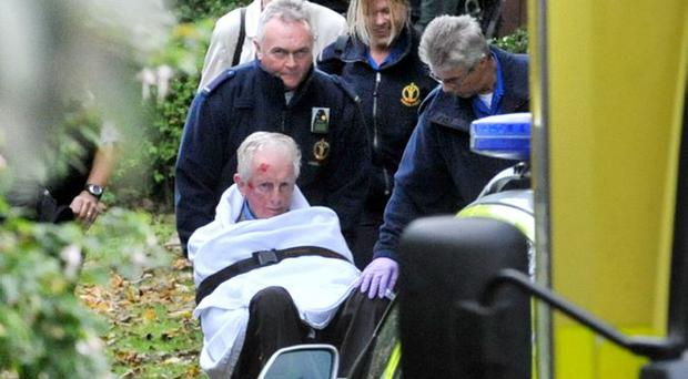 A man is taken to hospital with a head wound after the explosion at Kingsdale Park near police HQ in East Belfast . October 16, 2009