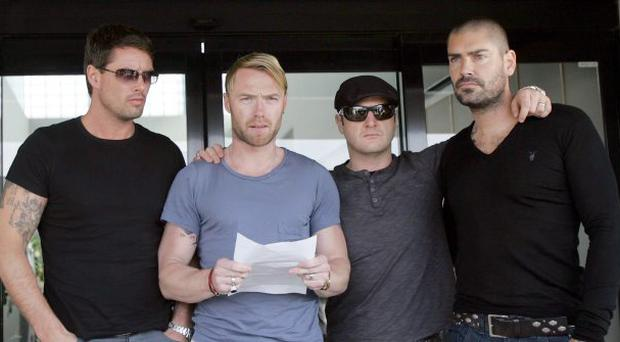 Members of Boyzone (from left) Keith Duffy, Ronan Keating, Mikey Graham and Shane Lynch make a statement outside Majorca Airport as Stephen Gately's body is placed in to the hold of a plane which will fly to Dublin ahead of his funeral on Saturday.
