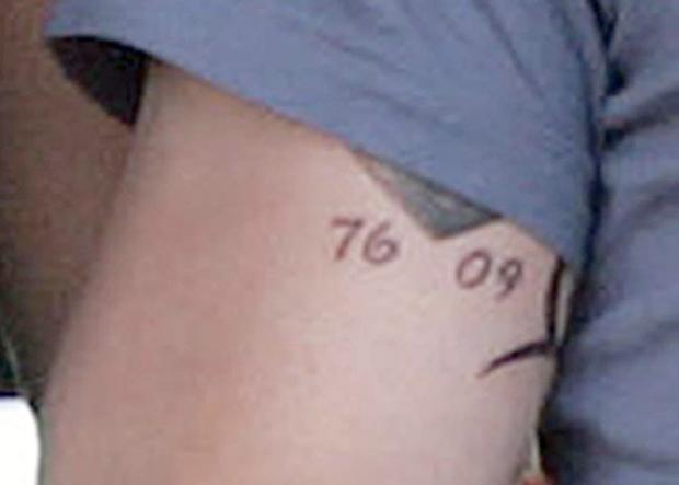 Close up of the tattoo on Ronan Keating's arm showing the number