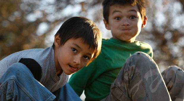 Falcon Henne (L), 6, and brother Ryo, 8, are shown outside their home October 15, 2009 in Ft. Collins, Colorado