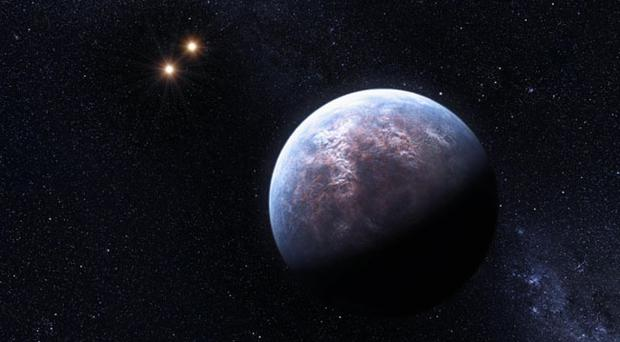 This artist rendering provided by the European South Observatory shows some of the 32 new planets astronomers found outside our solar system, adding evidence to the theory that the universe has many places where life could develop.