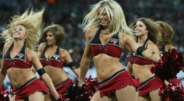 Cheerleaders perform during the NFL International Series match between New England Patriots and Tampa Bay Buccaneers at Wembley Stadium