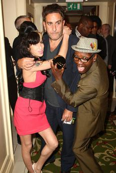 Amy Winehouse and Terry Hall (middle) attend the 2009 Q Awards held at the Grosvenor House Hotel on October 26, 2009 in London, England
