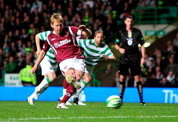 Hearts' Michael Stewart drills home the decisive goal from the penalty spot at Parkhead to dump Celtic out of the Co-operative Insurance Cup