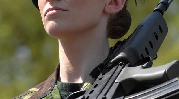 Lance Corporal Katrina Hodge, 21, a Military Clerk with the Adjutant General Corps