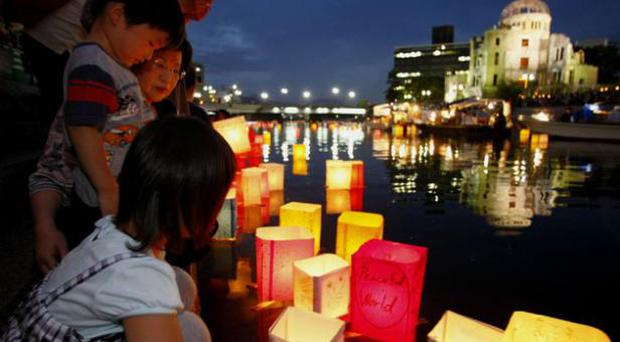 A Japanese family releases a paper lantern in Hiroshima to mark the 64th anniversary in August this year of the world's first atomic bomb attack