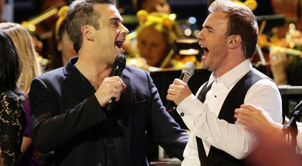 Robbie Williams and Take That's Gary Barlow join stars on stage for a special performance at the BBC Children in Need Rocks concert, at the Royal Albert Hall