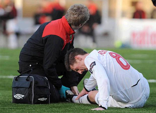 Daryl Fordyce receives treatment for an ankle injury on the new synthetic surface at Seaview which has come under criticism