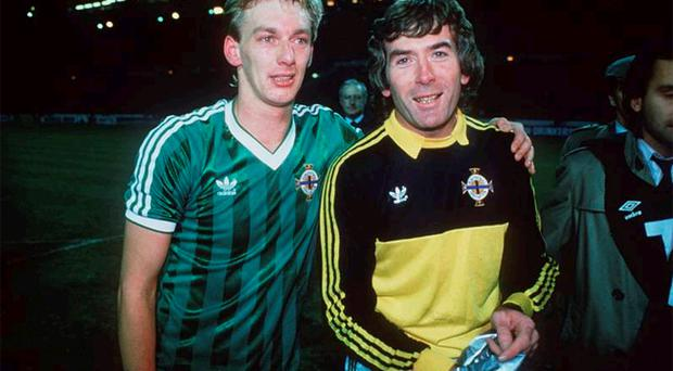Alan McDonald with Pat Jennings at the end of the Wembley qualifier that saw Northern Ireland reach the 1986 World Cup finals