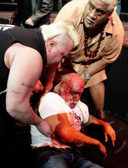 Hulk Hogan is helped by the 'Nasty Boys' Brian Knobbs and Solofa Fatu Jnr after an altercation with Rick Flair during a press conference for Hulkamania