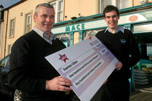 Damien Gillan (left) with Malachy McCaughan whose Mace shop in Armoy sold the 40 year old plasterer a winning lotto ticket worth over £137,000.