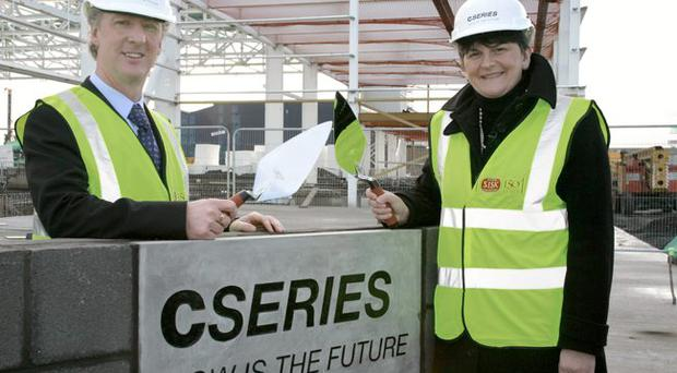 Michael Ryan, general manager of Bombardier Aerospace in Belfast, and Enterprise Minister Arlene Foster lay a special corner stone to mark the construction of Bombardier's new CSeries factory
