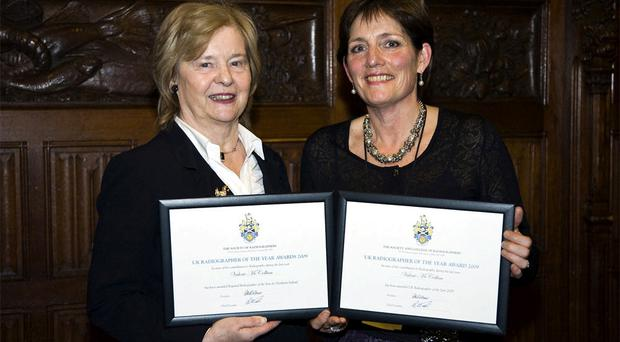 Valerie (right) receives her awards from Labour's Baroness Golding