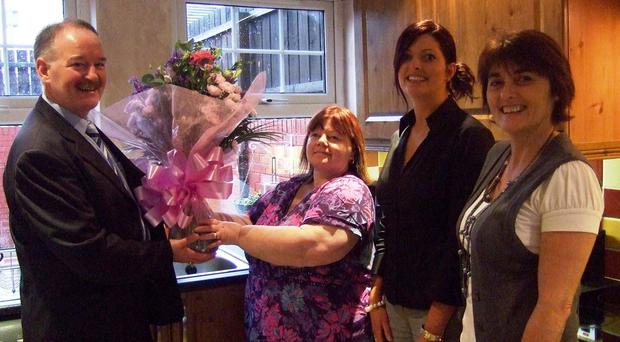 (L-r) Francie Brown of the Housing Executive, resident Margaret Lagan, Seana Hippsley of PK Murphy Contractors, and Anne Mathers of the Housing Executive