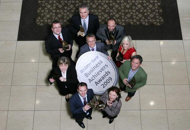 Ian Jordan from Ulster Bank (centre) joins award winners Michael Hall from Kestrel Foods; Jurgen Prause from rehabstudio; Ruth Connolly from First Derivatives; Geoff Baird from Lir-med; Marie Marin from Employers For Childcare Vouchers; Declan Gallagher from Oilean Glas Teo, Marian Donnelly from Silver Hill Foods and Colin Ferguson from Willowbrook Foods
