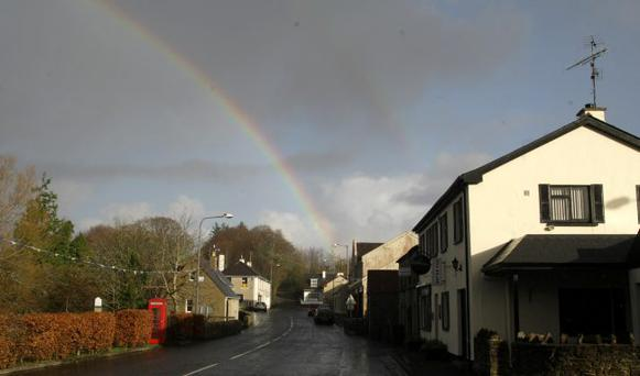 25/11/09 Pictures by David Fitzgerald A rainbow appears after the recent heavy rain over the small village of Garrison in County Fermanagh which was the scene of a recent foiled attempt on the life of a PSNI officer.