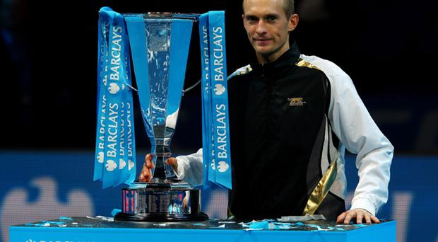 Nikolay Davydenko grasps the prize after his stunning win in the ATP World Tour Finals