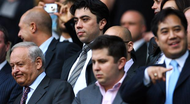 Kia Joorabchian, pictured here watching a Manchester City game, profited from Carlos Tevez's move to the club