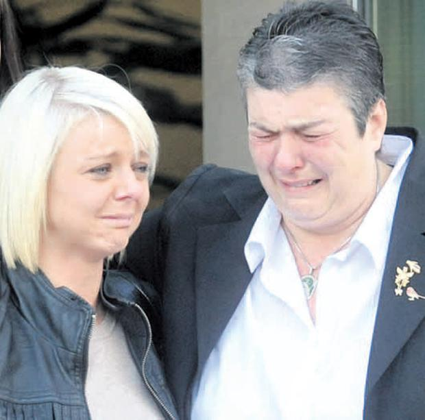 A distraught Shirley Whiteside leaves court with daughter Alana