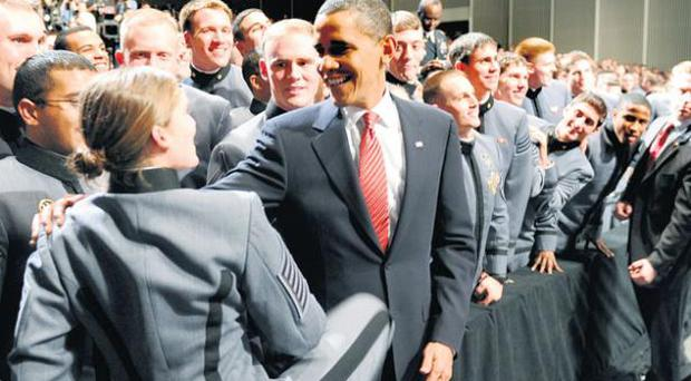Soldiers greet President Barack Obama after he announced extra troops for Afghanistan at the US Military Academy at West Point on Tuesday