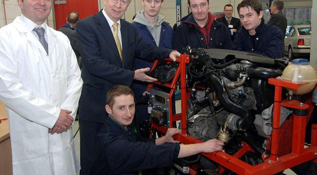 Sir Reg Empey, Minister for Employment and Learning, joins Raymond Fitzpatrick, Lecturer Motor Vehicle Science and trainees at the South West College at the launch of a new £9 million Technology and Skills Centre in Enniskillen.
