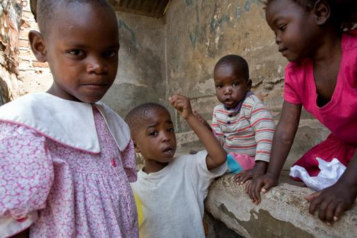 Family pressures — Gloria (left) with her brother Aggrey Amwanda (3), 20-month-old sister, Musungu, and a pal