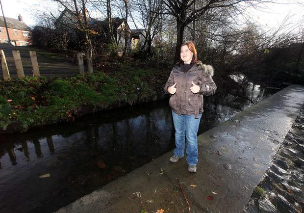Belfast Telegraph reporter Linda Stewart at the Connswater River in east Belfast before and after it was cleaned up by young men on probation
