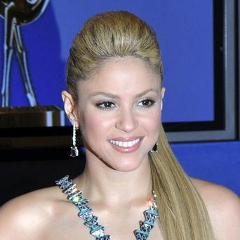 Shakira says she likes having short legs