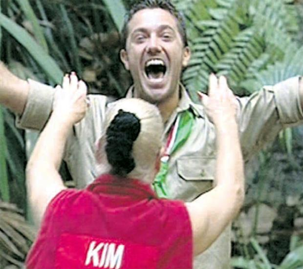 Last man standing: Gino D'Acampo celebrates being named king of the jungle ahead of Kim Woodburn