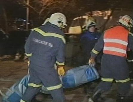 In this image from RTR Russian Channel, rescuers carry the body of a victim outside a nightclub in Perm, Russia, early Saturday, Dec. 5, 2009