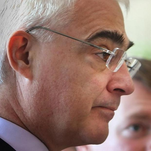 Alistair Darling is considering hitting bankers with a windfall tax on their bonuses