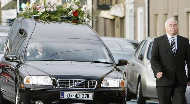The funeral of folk singer Liam Clancy makes its way to St Mary's Church, Dungarvan, Co Waterford