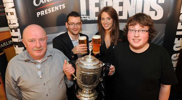 Alistair and Adam Carson from Mourneview in Lurgan are pictured with Glenavon Legend Gerard McMahon and Carling's Lisa Morrow at Mourneview Park for the 'Carling Presents an Evening of Legends' event