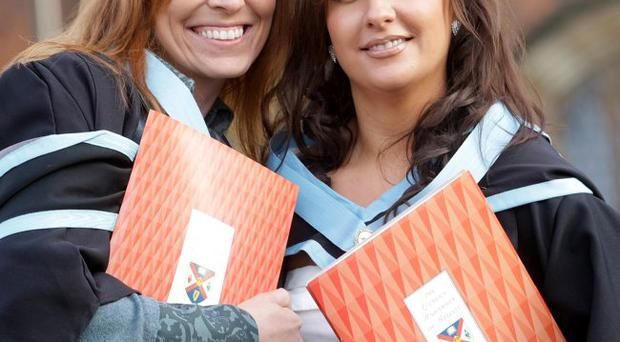 Toni McCaul (left) and Florence Herbert, who received degrees in midwifery at the Queen's University winter graduations yesterday