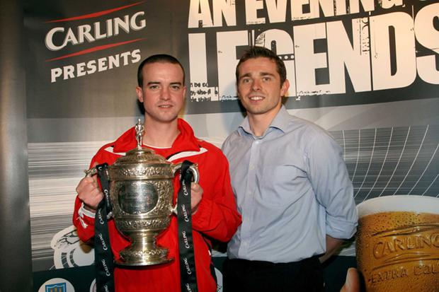 Nolan Devlin from West Belfast is pictured with Cliftonville striker Chris Scannell at Solitude for the 'Carling Presents an Evening of Legends' event