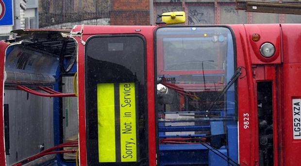 The scene in Clapham, south London, after a double-decker bus overturned