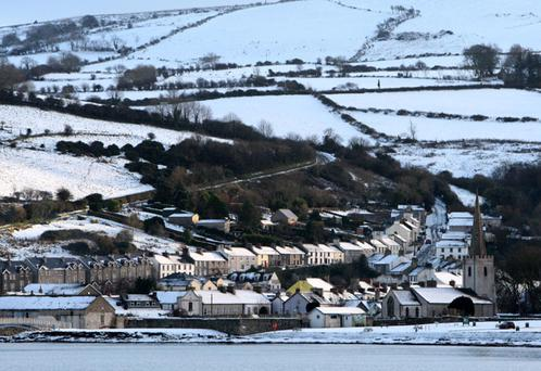 The snow covered coastal village of Glenarm in Co Antrim
