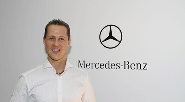 The Mercedes GP Petronas Formula One team have confirmed that 7-times Formula One World Champion Michael Schumacher will make his racing return in 2010 with the Silver Arrows team. Above: Schumacher poses on December 23, 2009 in Brackley, England