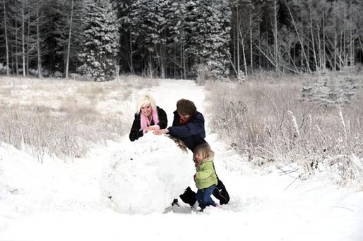 A young family enjoying a winter wonderland in County Antrim