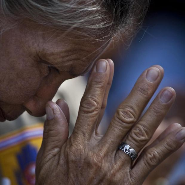 A Thai woman offers prayers to remember those killed in the 2004 tsunami (AP)