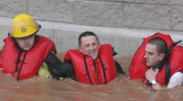 Firemen rescue Belfast man Kevin Curran after his car was submerged