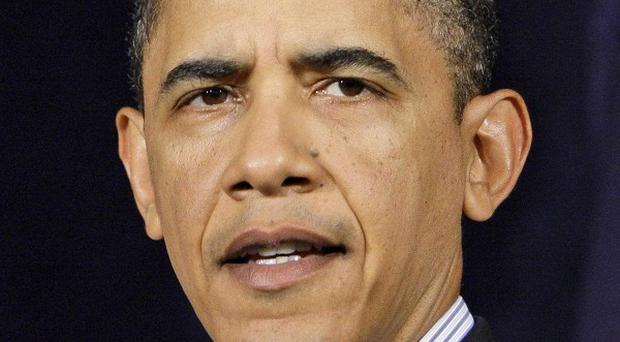 President Barack Obama blamed 'flaws' for the failed airliner plot (AP)