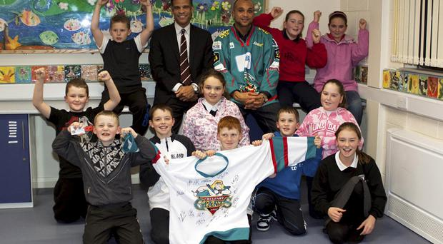 Michael McGrath and Sean McMorrow (top centre) with some of the kids from Woodvale Youth Club