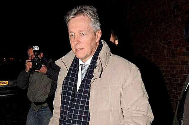 Northern Ireland's First Minister Peter Robinson leaves DUP headquarters in east Belfast last night