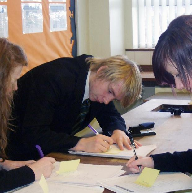Pupils Eimear Creaney, Cahal Judge and Niamh Chambers work on their project at Drumcree College in Portadown
