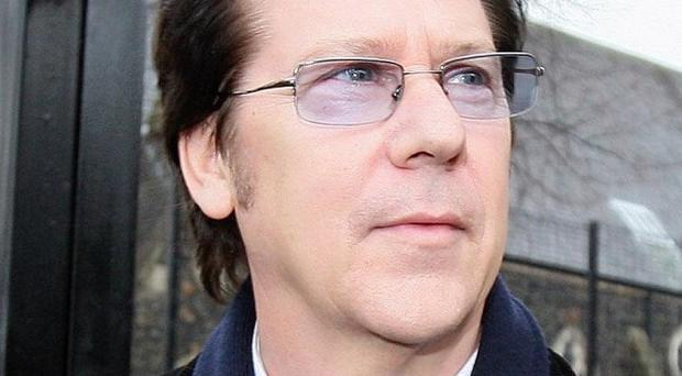 Former pop star Shakin' Stevens has been fined for striking a press photographer